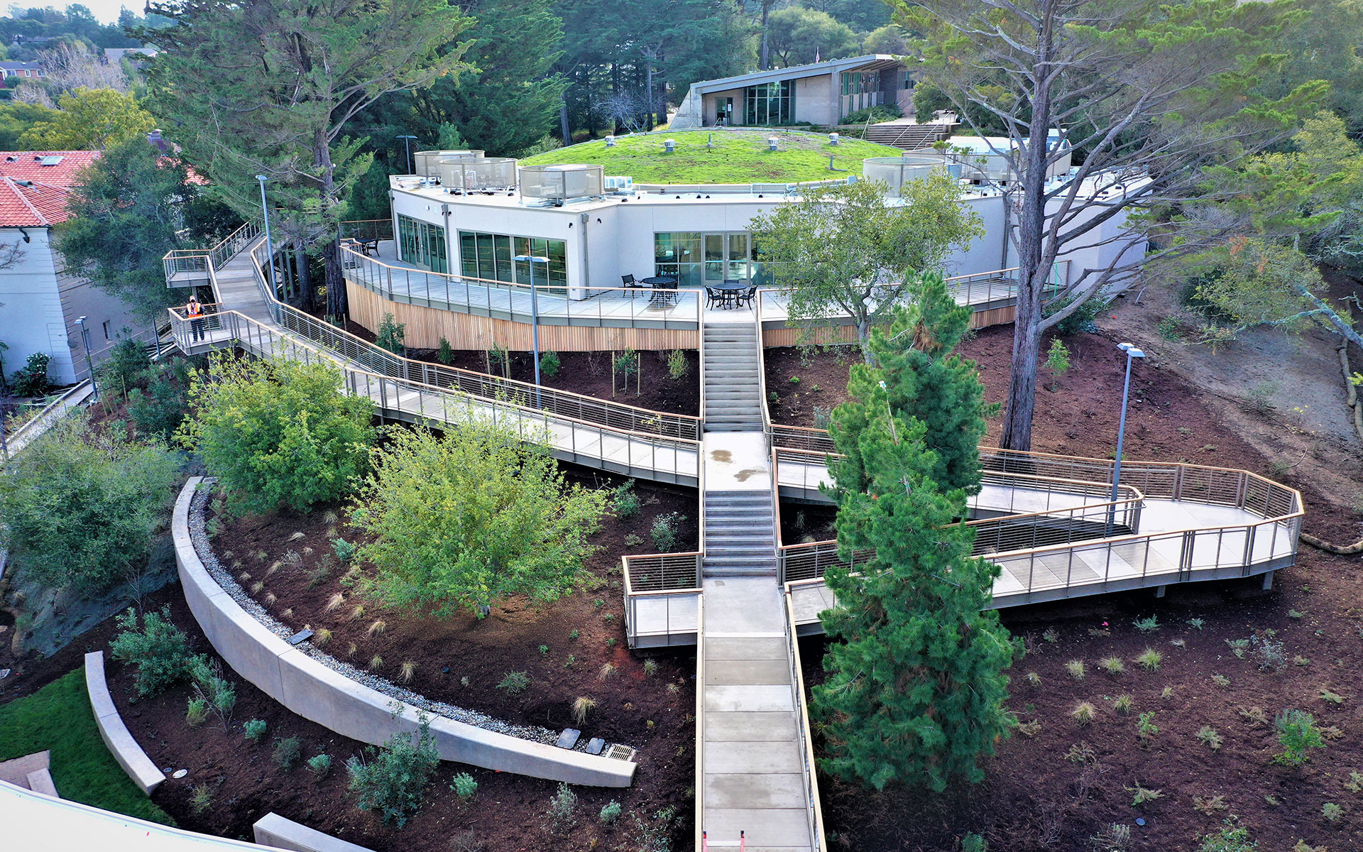 Private landscaping on hill with stairs leading up to home